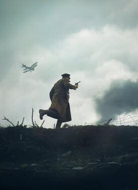 Mark Owen SOLDIER WITH GUN RUNNING IN BATTLEFIELD WITH PLANE