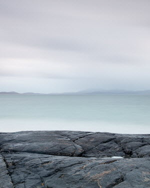 David Baker SEA AND ROCKS WITH DISTANT COASTLINE