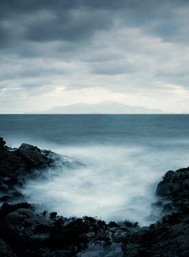 David Baker MISTY SEA AND ROCKS WITH DISTANT ISLAND