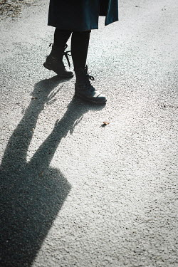 Shelley Richmond FEMALE FEET IN BOOTS ON ROAD WITH SHADOW
