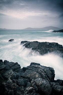 David Baker SEA AND ROCKS WITH DISTANT COASTLINE