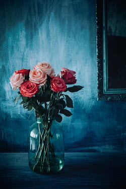 Magdalena Wasiczek VASE OF ROSES ON TABLE WITH MIRROR