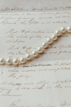 Matilda Delves PEARL NECKLACE LYING ON LETTER