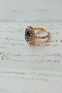 Matilda Delves GOLD AND DIAMOND RING LYING ON LETTER