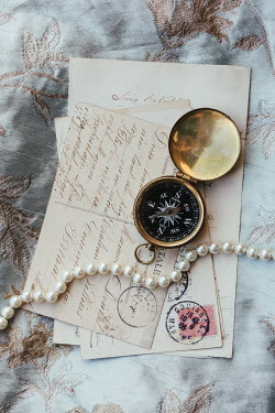 Matilda Delves COMPASS PEARLS AND POSTCARDS ON FLORAL FABRIC
