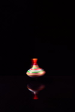 Magdalena Russocka spinning top toy on glossy surface