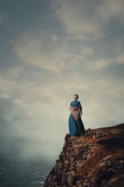 Magdalena Russocka historical woman with shawl standing on cliff