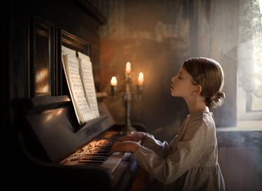 Sveta Butko LITTLE GIRL PLAYING PIANO WITH GLOWING CANDELABRA