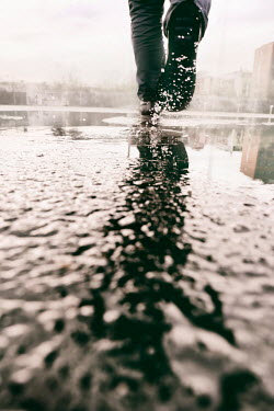 Tim Robinson MAN WALKING IN PUDDLE