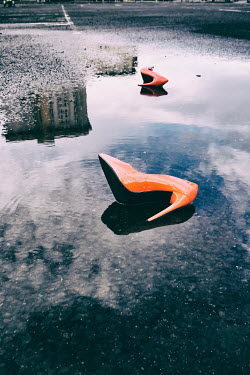 Tim Robinson ORANGE STILETTOS LYING IN CARPARK PUDDLE