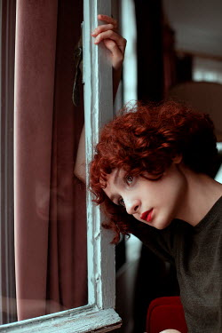 Ebru Sidar WOMAN WITH RED HAIR DAYDREAMING BY WINDOW