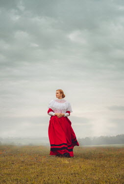 Joanna Czogala HISTORICAL WOMAN WITH RED HAIR WALKING IN FIELD