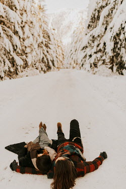 Muna Nazak COUPLE LYING IN SNOWY COUNTRYSIDE