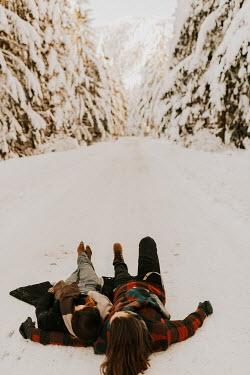 Muna Nazak COUPLE LYING IN SNOWY COUNTRYSIDE