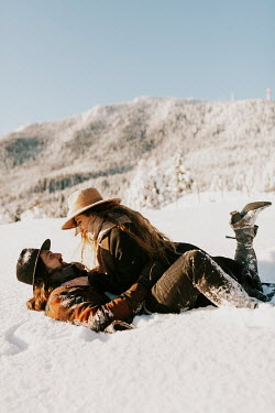 Muna Nazak HAPPY COUPLE LYING IN SNOWY COUNTRYSIDE