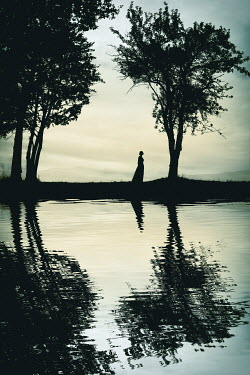 Magdalena Russocka silhouettes of historical woman and trees by river
