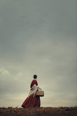 Magdalena Russocka historical woman carrying basket walking in countryside