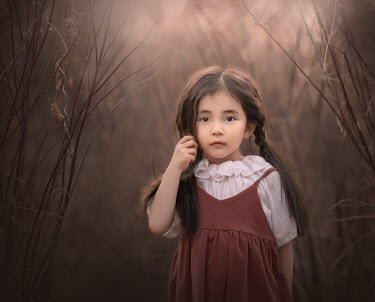 Sveta Butko SERIOUS LITTLE ASIAN GIRL STANDING IN COUNTRYSIDE