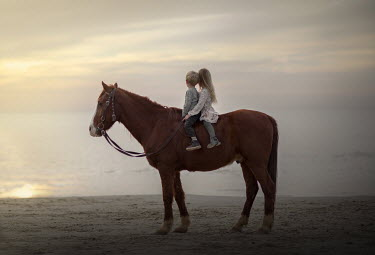 Sveta Butko LITTLE BOY AND GIRL ON HORSE WATCHING OCEAN