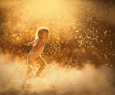 Sveta Butko HAPPY LITTLE GIRL RUNNING WITH FLOATING SEEDS