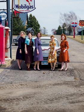 Elisabeth Ansley RETRO WOMEN WITH CAR AT GAS STATION