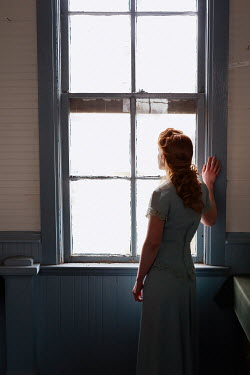Elisabeth Ansley RETRO WOMAN WITH RED HAIR WATCHING AT WINDOW