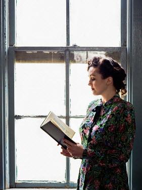 Elisabeth Ansley BRUNETTE RETRO WOMAN READING BOOK BY WINDOW