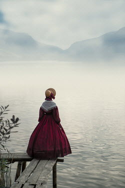 Magdalena Russocka historical woman standing on jetty by lake