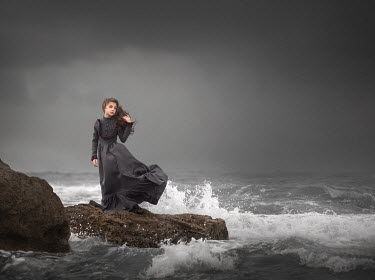 Sveta Butko HISTORICAL WOMAN ON ROCK BY STORMY SEA
