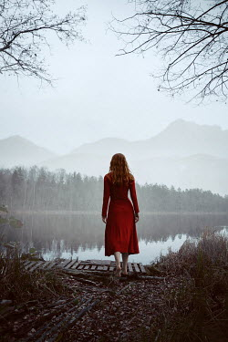 Natasza Fiedotjew woman in red dress at mountain lake