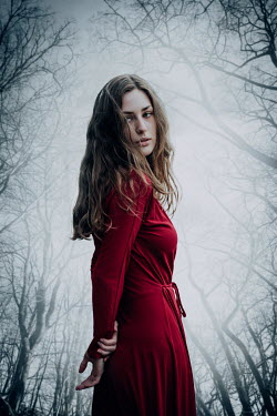 Natasza Fiedotjew young woman in red dress surrounded by bare tree branches