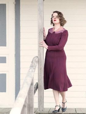 Elisabeth Ansley 1940S WOMAN IN DRESS ON VERANDA OUTDOORS