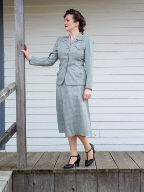 Elisabeth Ansley 1940S WOMAN IN SUIT OUTSIDE ON VERANDA