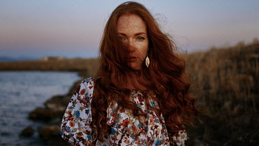 Georgy Chernyadyev WOMAN WITH RED HAIR BY SEA AT DUSK