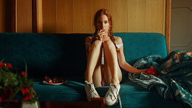 Georgy Chernyadyev GIRL WITH PLAITED RED HAIR SITTING ON COUCH