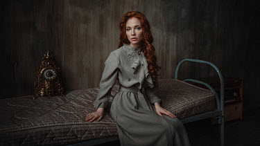 Georgy Chernyadyev WOMAN WITH RED HAIR SITTING IN BLEAK BEDROOM