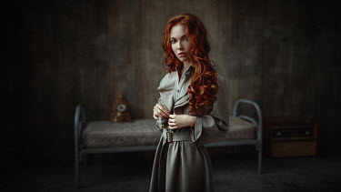 Georgy Chernyadyev WOMAN WITH RED HAIR STANDING IN BLEAK BEDROOM