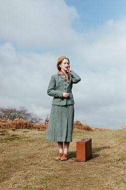 Matilda Delves 1940S WOMAN WITH SUITCASE IN COUNTRYSIDE