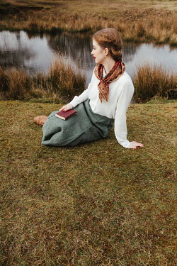 Matilda Delves RETRO GIRL WITH BOOK SITTING BY POND