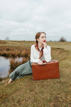 Matilda Delves RETRO WOMAN WITH SUITCASE BY POND