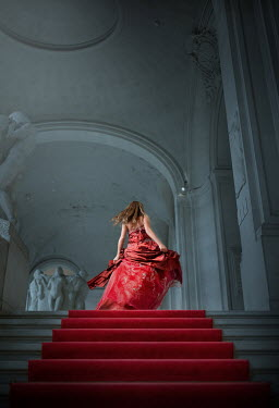 Sveta Butko WOMAN IN RED GOWN RUNNING IN GRAND BUILDING