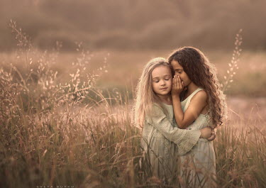 Sveta Butko GIRL WHISPERING TO FRIEND IN COUNTRYSIDE