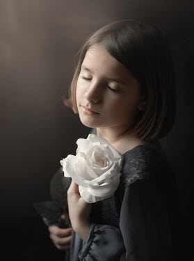 Sveta Butko DAYDREAMING YOUNG GIRL WITH WHITE FLOWER