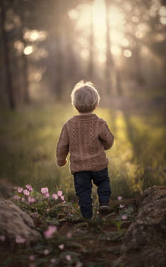 Sveta Butko BLONDE LITTLE BOY WALKING IN SPRING COUNTRYSIDE