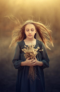 Sveta Butko YOUNG BLONDE GIRL HOLDING GRASSES WITH FLOWING HAIR