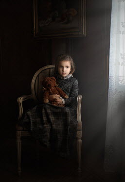 Sveta Butko LITTLE GIRL WITH TEDDY SITTING IN HOUSE