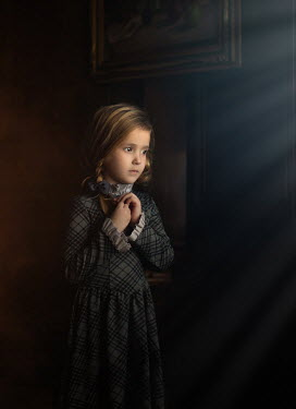 Sveta Butko SERIOUS LITTLE GIRL IN SHADOW INDOORS