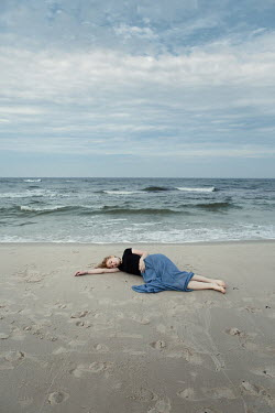 Magdalena Russocka woman lying on beach