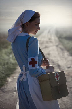 Natasza Fiedotjew war nurse holding medic bag on country road