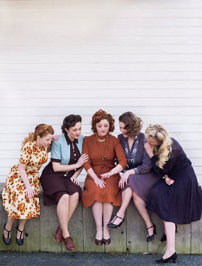 Elisabeth Ansley HAPPY GROUP OF RETRO WOMEN SITTING ON VERANDA
